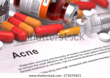 Acne - Printed Diagnosis with Blurred Text. On Background of Medicaments Composition - Red Pills, Injections and Syringe. - stock photo