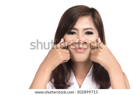 Acne spot pimple spot skincare beauty care Asian woman pressing on skin problem face, Closeup portrait of Asian woman, Thai girl, isolated on white background