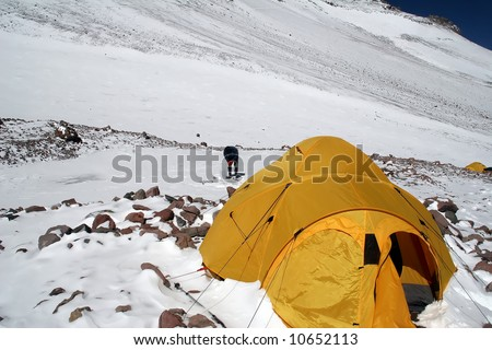 Aconcagua water source through frozen ice at Camp Two - stock photo