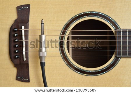 Acoustic Guitar and Cable Cord - stock photo