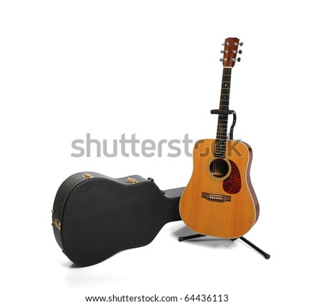 Acoustic guitar and plush case isolated against white background - stock photo