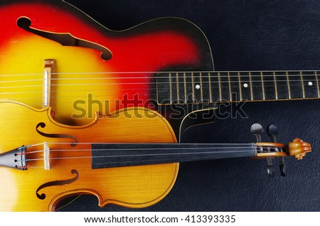 Acoustic guitar and violin - stock photo