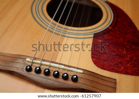 acoustic guitar - bridge close up - stock photo