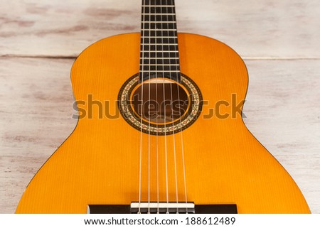 Acoustic guitar close up from above - stock photo