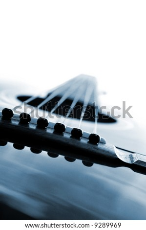 Acoustic guitar close up on white background - stock photo