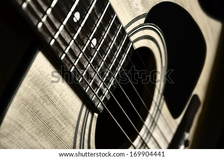 acoustic guitar closeup, black and white