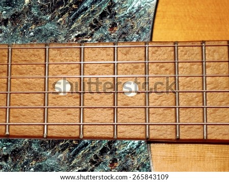 acoustic guitar, guitar on rock background - stock photo