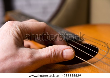 Acoustic guitar guitarist playing. Musical instrument with performer hands. Artist art song. - stock photo