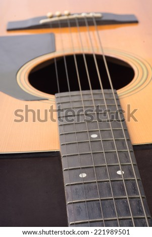 acoustic guitar isolated on a white background