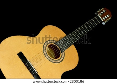 Acoustic guitar isolated on black - stock photo