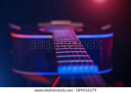 acoustic Guitar on a bright background closeup - stock photo