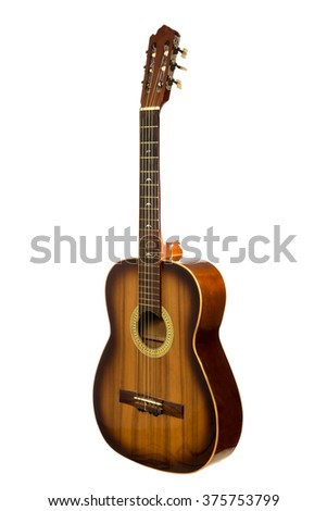 Acoustic guitar on black background - stock photo