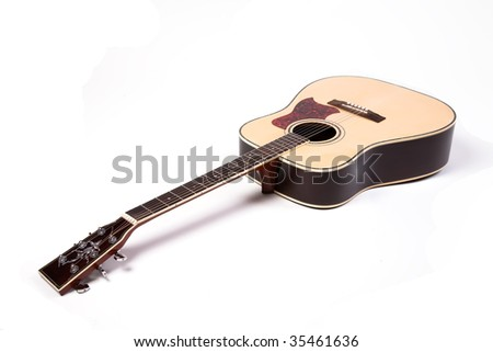 Acoustic guitar on white - stock photo