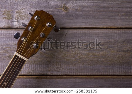 Acoustic guitar on wood background - stock photo