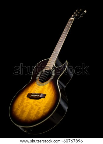 acoustic guitar over black background, useful for various music related themes - stock photo