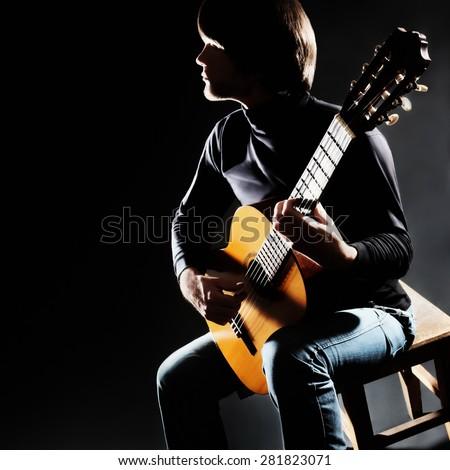 acoustic guitar player guitarist classical guitar stock photo 335030222 shutterstock. Black Bedroom Furniture Sets. Home Design Ideas