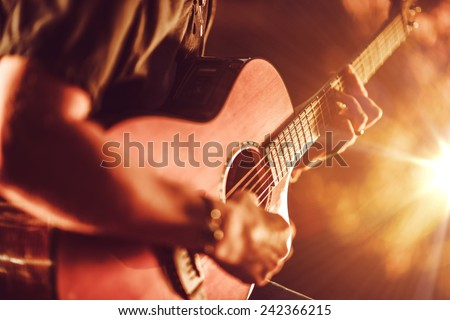 Acoustic Guitar Playing. Men Playing Acoustic Guitar Closeup Photography. - stock photo