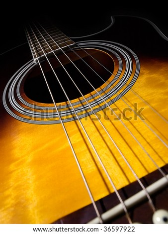 acoustic guitar, shot taken from low angle perspective ,fading into dark, low key