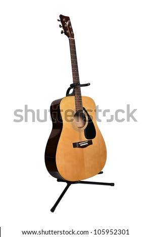 acoustic guitar stand on a white background - stock photo