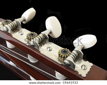 Acoustic guitar tuning pegs - stock photo