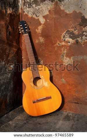 acoustic guitar with rusty background