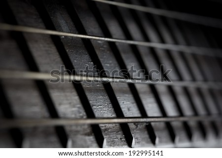 Acoustic Guitar with very shallow depth of field - stock photo