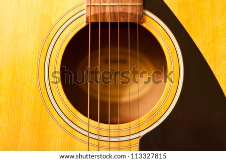 Acoustic guitar wood color close - up.  The guitar background. - stock photo