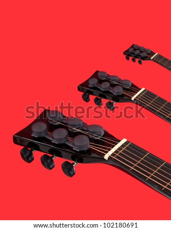 Acoustic guitars heads necks - stock photo