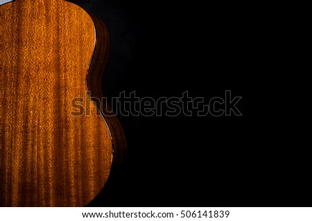 Acoustic instrument Close-up  some ukulele on a black background Space for text template  music