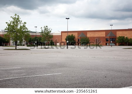 Acres of empty parking spaces at a mall. - stock photo