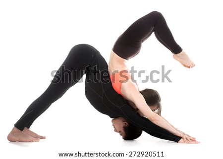 Acro yoga, two sporty people practice yoga in pair, couple doing stretching exercise for spine, scorpion and downward facing dog posture, white background - stock photo