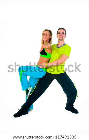 Acrobatic dancing with two young trainers on white background - stock photo