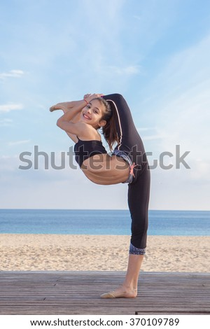 acrobatic flexible young girl dancer stretching - stock photo