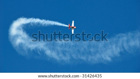 Acrobatic plane in action. - stock photo