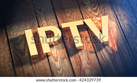 "Acronym ""IPTV"" is lined with gold letters on wooden planks. 3D illustration image"