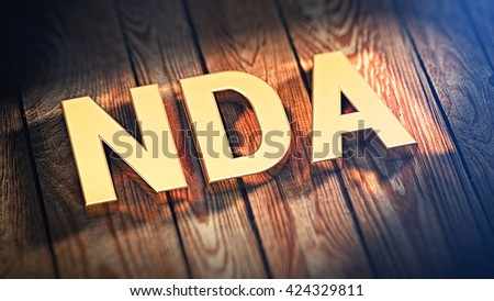 "Acronym ""NDA"" is lined with gold letters on wooden planks. 3D illustration image - stock photo"