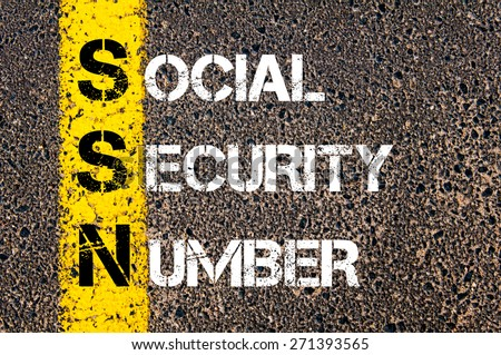 Acronym SSN as Social Security Number. Yellow paint line on the road against asphalt background. Conceptual image - stock photo