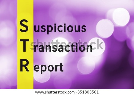 Acronym STR as Suspicious Transaction Report. Background with defocused lights.