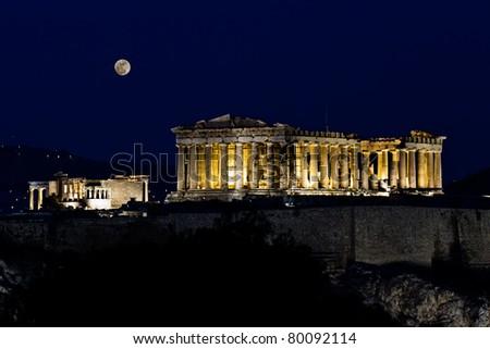 Acropolis (Parthenon) by night, under full moon,  Athens, Greece - stock photo