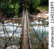 Across the suspension bridge waterfall,Thailand - stock photo