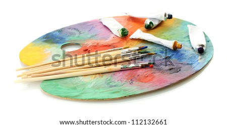 acrylic paint, paint tubes and brushes on wooden palette, isolated on white - stock photo