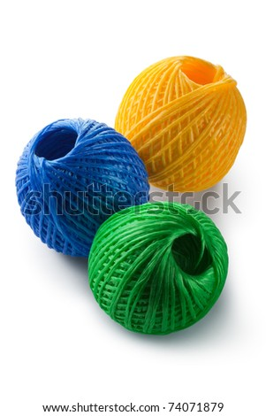 Acrylic yarn clews - green, blue and yellow. Isolated on white.