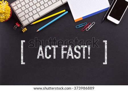 ACT FAST! CONCEPT ON BLACKBOARD - stock photo