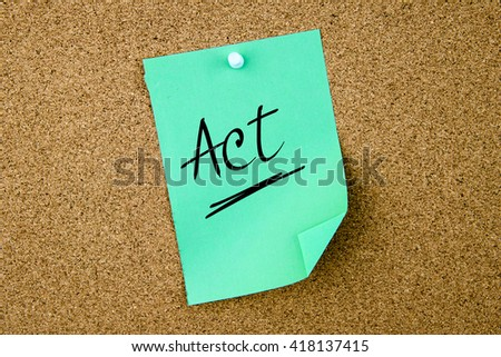 Act  written on green paper note pinned on cork board with white thumbtacks, copy space available