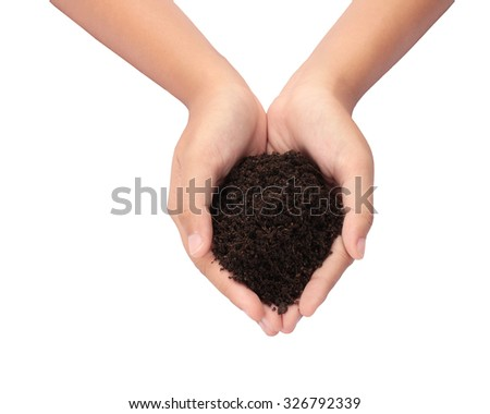 Acting Soil in hand isolated on white background with clipping path. - stock photo