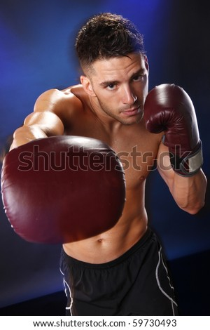 Action boxer gloves on in training attitude - stock photo