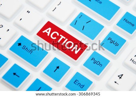 Action button on a computer keyboard, business concept