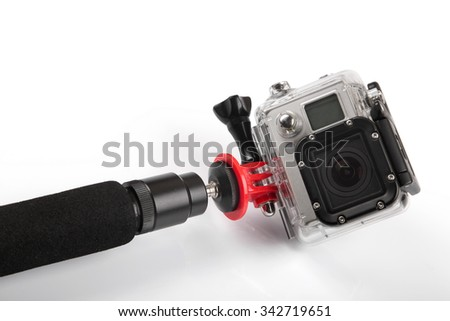 action camera with handheld stick isolated on white - stock photo
