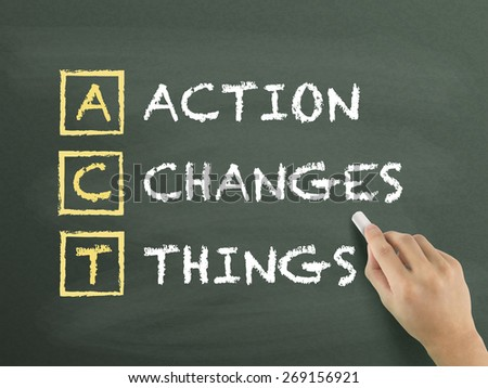 Action Changes Things written by hand on blackboard - stock photo