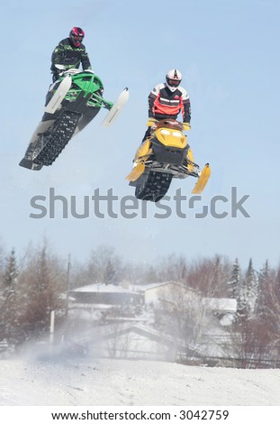 action from kirkland lake snowmobile races - stock photo